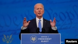 U.S. President-elect Joe Biden delivers a televised address to the nation, after the U.S. Electoral College formally confirmed his victory over President Donald Trump in the 2020 U.S. presidential election, from Biden's transition headquarters in Wilmingt