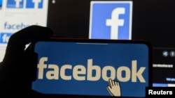 facebookFILE PHOTO: The Facebook logo is displayed on a mobile phone in this picture illustration taken December 2, 2019. REUTERS/Johanna Geron/Illustration/File Photo