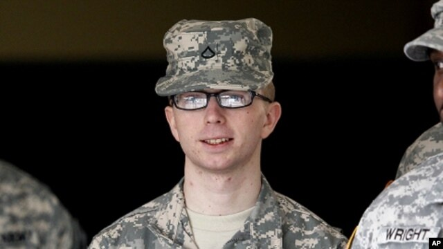 In this file photo taken Dec. 22, 2011, Army Pfc. Bradley Manning is escorted from a courthouse in Fort Meade, Maryland.