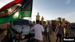 Libyan security forces evict an armed group from a compound in Tripoli, Sept. 23, 2012.
