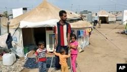 2013年9月22日在伊拉克首都巴格达北部350公里之外的一个叙利亚难民营的照片。