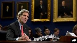 FILE - Secretary of State John Kerry testifies on Capitol Hill in Washington.