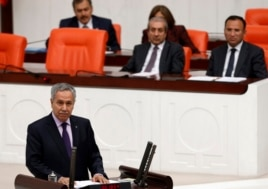 FILE -Turkey's Deputy Prime Minister Bulent Arinc addresses the Turkish Parliament in Ankara, Oct. 31, 2013.