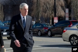 FILE - Special Counsel Robert Mueller walks to his car after attending services at St. John's Episcopal Church, across from the White House, in Washington, March 24, 2019.