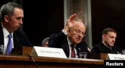 FILE - Director of National Intelligence James Clapper testifies before a Senate Armed Services Committee hearing on foreign cyber threats, on Capitol Hill in Washington, Jan. 5, 2017.