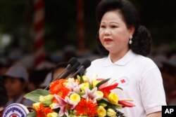 Cambodian Red Cross head Bun Rany Hun Sen gives a speech during ceremonies held ahead of the May 8 World Red Cross Day and Red Crescent Day in Phnom Penh, Cambodia, Tuesday, May 3, 2011. (AP Photo/Heng Sinith)