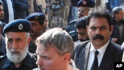 Pakistani police escort arrested US national, identified as Raymond Davis (C), to a court in Lahore on January 28, 2011
