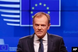 FILE - European Council President Donald Tusk speaks during a media conference on Brexit at the Europa building in Brussels, March 20, 2019.