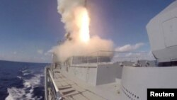 A still image taken from a video footage and released by Russia's Defense Ministry on Nov. 15, 2016, shows cruise missiles being launched from Russian Admiral Grigorovich frigate deployed off Syria coast.
