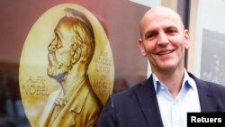 German scientist Benjamin List, who shares the 2021 Nobel Prize in Chemistry together with David MacMillan for the development of asymmetric organocatalysis, poses at the Max-Planck-Institute for Coal Research in Muelheim an der Ruhr, Germany, October 6,