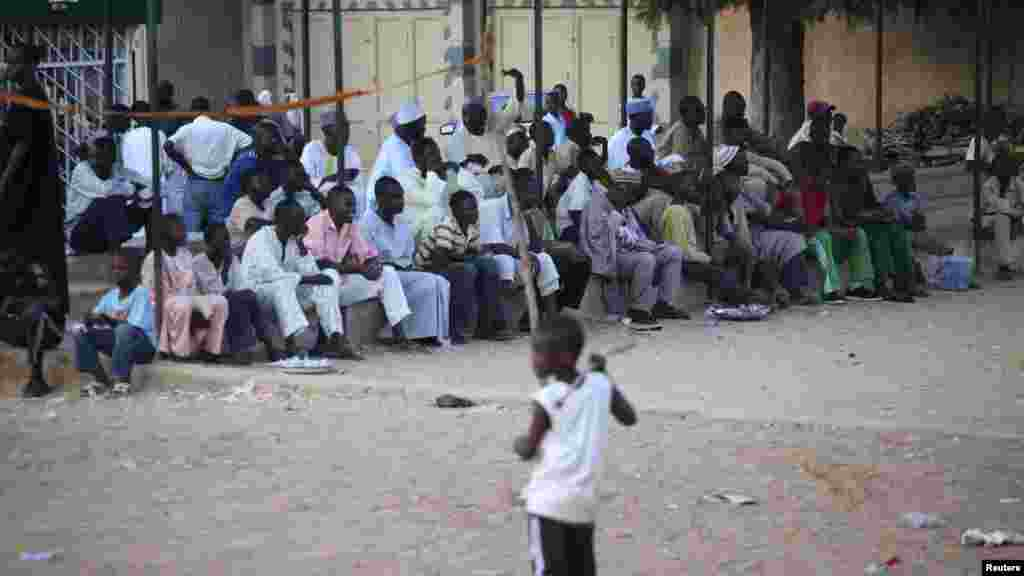 People watch as youths play a game of Eton fives in a court in Katsina.