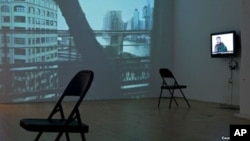 "A video installation in the Winkleman Gallery ""Brooklyn Bridge"" exhibition by Gulnara Kasmalieva and Muratbek Djumaliev in New York City"