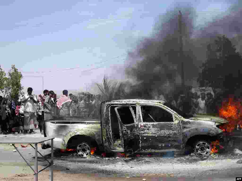The car of Lieutenant Colonel Mohammed al-Saidi after it was targeted by a suicide bomber in the southern Yemeni city of Ataq. A suicide bomber killed the army intelligence officer when he detonated his explosive-laden car in a market, a security official said.