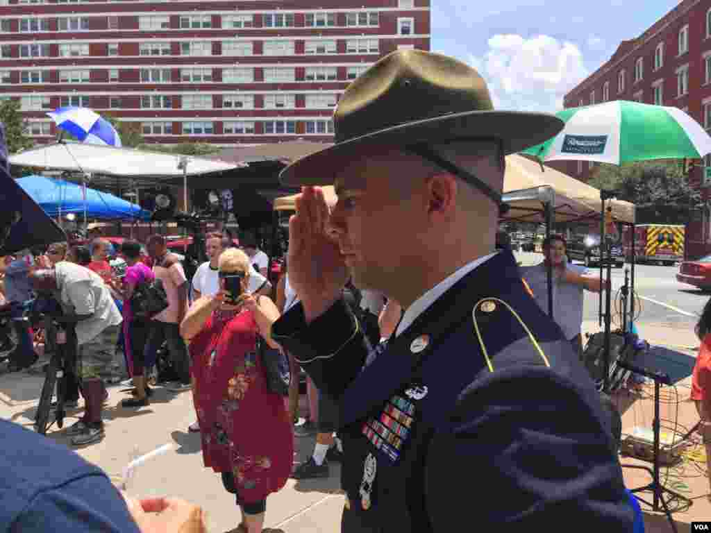 U.S. Army retired Combat Medic Chandler Davis stood in quiet salute for hours at a makeshift memorial outside the Dallas Police Headquarters, in Dallas, Texas, July 9, 2016.