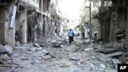 11일 정부군의 공격으로 폐허가 된 다마스쿠스의 거리.