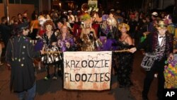Members of the Krewe du Vieux paraded through the streets of the French Quarter celebrating the Mardi Gras season in New Orleans