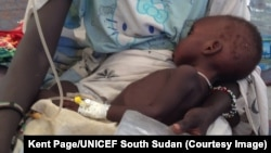 FILE - A child is treated for cholera in South Sudan.