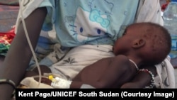 A child is treated for cholera in South Sudan. Malnourishment resulting from the ongoing crisis in the country has left children even more vulnerable to the disease, which has killed 37 people as of June 18, 2014.