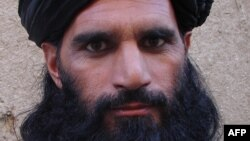 FILE - Asmatullah Shaheen Bhittani, the head of the supreme shura in the Waziristan tribal area near the Afghan border, June 2012.