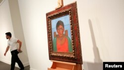 "Artist Frida Kahlo's painting ""Nina Con Collar"" sits on an easel at Sotheby's auction house in New York, Nov. 14, 2016. The painting sold for $1.81 million Tuesday, Nov. 22, 2016."