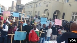 Protesters march in Harare demanding the resignation of Zimbabwe's education minister.