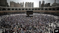 FILE - Muslim pilgrims circle the Kaaba, the cubic building originally built by the Archprophet Abraham in the holy city of Mecca, Saudi Arabia, Aug. 28, 2017.