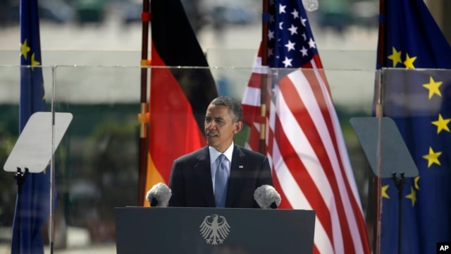 U.S. President Barack Obama speaks in front of the iconic Brandenburg Gate, in Berlin, Germany, June 19, 2013.
