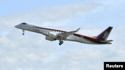 Mitsubishi Aircraft Corp's Mitsubishi Regional Jet (MRJ) takes off for a test flight at Nagoya Airfield in Toyoyama town, Aichi Prefecture, central Japan, in this photo taken by Kyodo November 11, 2015.