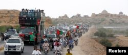 The convoy of Bilawal Bhutto Zardari, chairman of the Pakistan People's Party, passes the Makkli necropolis, during a campaign rally ahead of general elections in District Thatta, Pakistan, July 2, 2018.