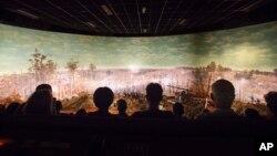 FILE - Visitors view the Atlanta Cyclorama, the colossal Civil War painting in Atlanta, June 30, 2015.