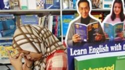 A Malaysian woman reads at a book fair in Kuala Lumpur