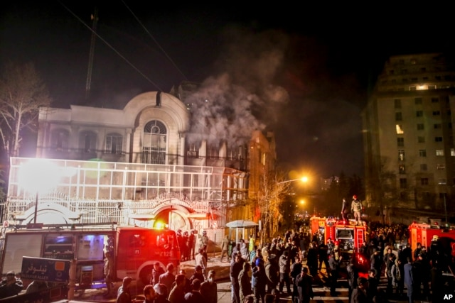 FILE - Smoke rises as Iranian protesters set fire to the Saudi embassy in Tehran, Jan. 3, 2016. Saudi Arabia canceled a multi-billion-dollar arms package after Lebanon failed to condemn the attack.