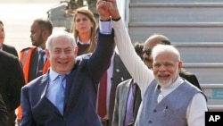 Israel's Prime Minister Benjamin Netanyahu, left, is welcomed by India's Prime Minister Narendra Modi on his arrival at Palam airport in New Delhi, Jan. 14, 2018.