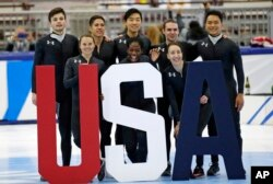 Nominees to the Olympic team, including Maame Biney (front row center), pose for a photo after the U.S. Olympic short track speedskating trials, Dec. 17, 2017, in Kearns, Utah.
