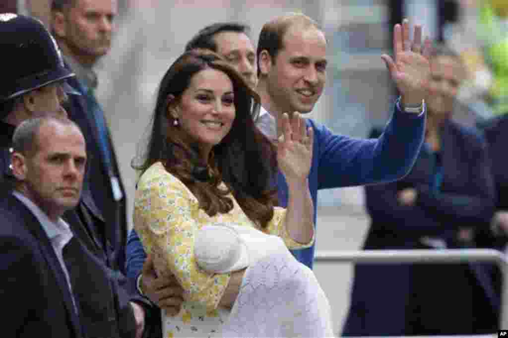 Britain's Prince William and Kate, Duchess of Cambridge and their newborn baby princess, wave to the public as they leave St. Mary's Hospital's exclusive Lindo Wing in London, Saturday, May 2, 2015. (AP Photo/Tim Ireland)