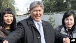 Former Prime Minister and Russia�s favored candidate, Almazbek Atambayev (C), who was declared winner of Kyrgyzstan's presidential elections Monday, talks to journalists in the capital Bishkek, October 31, 2011.