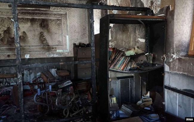 This photo published by Iranian state news agency IRNA shows the aftermath of a Dec. 18, 2018, fire at an all-girls school in the southeastern city of Zahedan. Three girls died in the blaze.