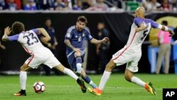 Argentina's Lionel Messi (10) takes a shot on goal past United States' Fabian Johnson (23) and Matt Besler (5) during a Copa America Centenario soccer semifinal in Houston, Texas, June 21, 2016. Argentina won 4-0.