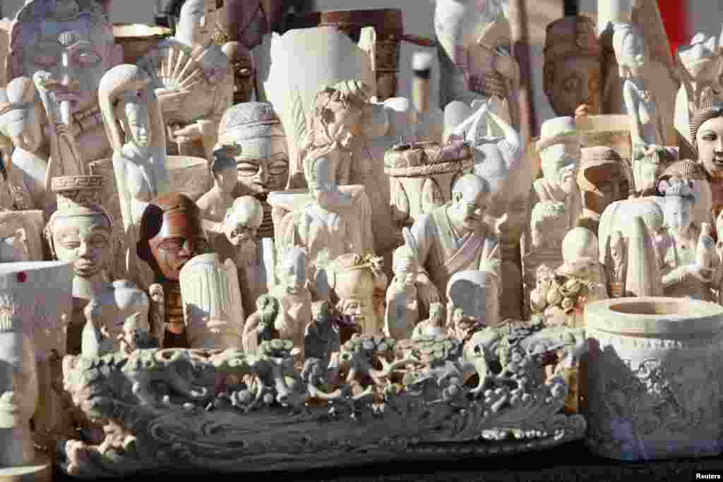 Dozens of confiscated carved ivory sculptures are displayed before 6 tons of ivory was crushed in Denver, Colorado, Nov. 14, 2013.