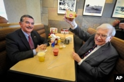 Berkshire Hathaway's Warren Buffett, right, at a Dairy Queen event on May 20, 2013 in Omaha, Nebraska.