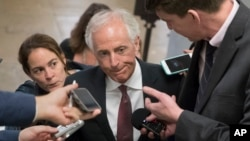 """FILE - Senate Foreign Relations Committee Chairman Sen. Bob Corker, R-Tenn. is surrounded by reporters on Capitol Hill in Washington, May 16, 2017. """"It's not an automatic for me. It just isn't,"""" Corker recently told reporters when asked whether he would seek reelection."""
