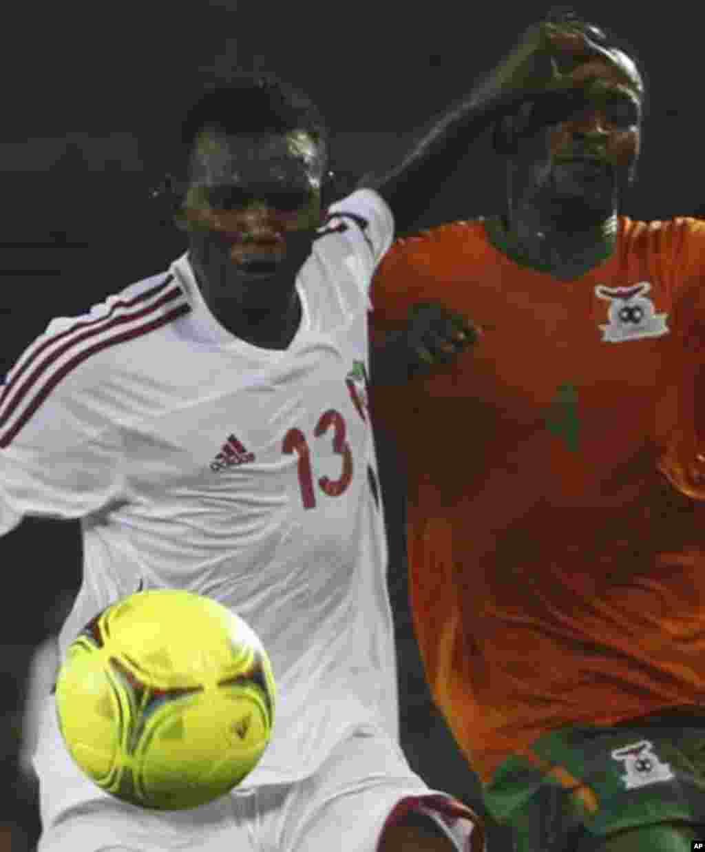 "Joseph Musonda of Zambia (R) fights for the ball with Amer Kamal of Sudan during their African Nations Cup quarter-final soccer match at Estadio de Bata ""Bata Stadium"", in Bata February 4, 2012."