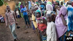 FILE - Refugees from Central Africa wait in Cameroonianian Garoua Boulaï border town for foods and clothes delivering by humanitarian associations.