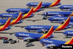 FILE - A number of grounded Southwest Airlines Boeing 737 MAX 8 aircraft are shown parked at Victorville Airport in Victorville, California, March 26, 2019.