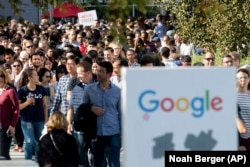 In this November 1, 2018, file photo, workers leave Google's Mountain View, California, main quad after some Google employees walked off the job in a protest against what they said is the tech company's mishandling of sexual misconduct allegations.