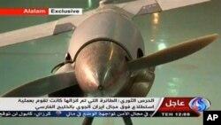 Gambar yang diambil dari televisi Iran berbahasa Arab ini menunjukkan pesawat yang mereka sebut sebagai pesawat tak berawak milik AS, ScanEagle (4/12).