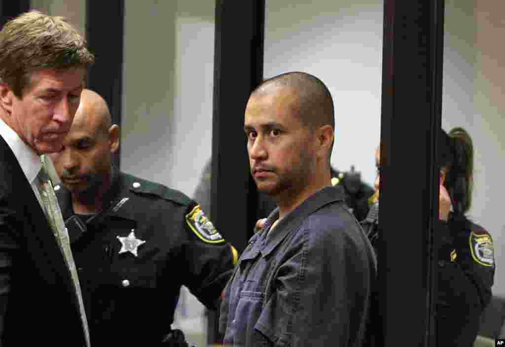 April 12: George Zimmerman, charged with second-degree murder in the shooting death of the 17-year-old Trayvon Martin, is directed by a Seminole County Deputy and his attorney Mark O'Mara during a court hearing in Sanford, Florida.