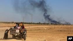 摩蘇爾外圍濃煙升起