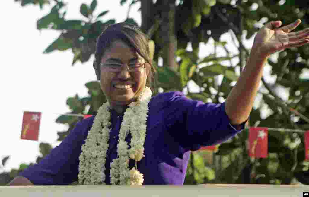 Phyu Phyu Thin, a prominent AIDS activist and a candidate of opposition National League for Democracy party, waves to supporters from a vehicle during her campaign in Minglataungnyunt township in Rangoon. (AP)