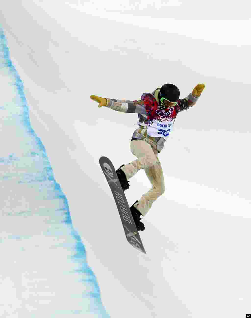Shaun White of the United States trains in the half pipe at Rosa Khutor Extreme Park, in Krasnaya Polyana, Russia, Feb. 9, 2014.